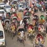 Rickshaws transport passengers in Dhaka, Bangladesh. — Stock Photo #61042201