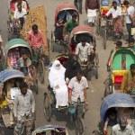 Rickshaws transport passengers in Dhaka, Bangladesh. — Stock Photo #61042215