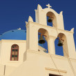 Bell tower and dome of an orthodox church in Oia, Santorini, Greece. — Stock Photo #61051871