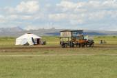 Mongolians have a picnic near the traditional yurt in steppe circa Harhorin, Mongolia. — Stock Photo