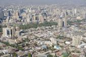 Aerial view of the Santiago city with the blue smog from the San Cristobal Hill, Santiago, Chile. — Stock Photo