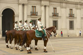 Military of the Carabineros band attend  changing guard ceremony in front of the La Moneda presidential palace in Santiago, Chile. — Stock Photo