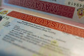 Passport page with Malaysian business visa. — Stock Photo