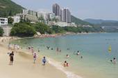 Tourists sunbathe at the Stanley town beach in Hong Kong, China. — Stock Photo