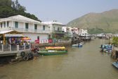 Tai O fishermen village with stilt houses and motorboats in Hong Kong, China. — Stock Photo