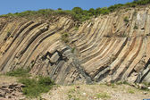 Bent hexagonal columns of volcanic origin at the Hong Kong Global Geopark in Hong Kong, China. — Stock Photo