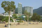 People sunbathe at the Stanley town beach in Hong Kong, China. — Stock Photo