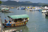 Man enters fishing boat at Sing Kee harbor in Hong Kong, China. — Stock Photo