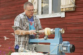 Man does carpenter work outside of his house in Korpilahti, Finland. — Stock Photo