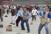 People practice tai chi chuan gymnastics in Beijing, China. — Stock Photo
