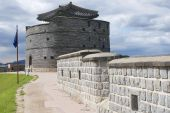 Tourist explores Hwaseong fortress (Brilliant Fortress) and tower in Suwon, South Korea. — Photo