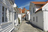 Tourist walks by the street of the old town in Stavanger, Norway. — Stock Photo