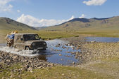 Mongolian people relocate nomadic tent by car in Kharkhorin, Mongolia. — Stock Photo