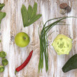 Set of green vegetables on white painted wooden background: kohlrabi, avocado, brussels sprouts, apple, pepper, green onion, pea pods, dill, basil. — Stock Photo #66315001