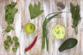 Set of green vegetables on white painted wooden background: kohlrabi, avocado, brussels sprouts, apple, pepper, green onion, pea pods, dill, basil. — Stock Photo