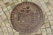 Exterior of the decorated sewer manhole in Bergen, Norway. — Stock Photo