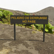 "Sign ""Danger of land slide, do not pass"" at the side of the Irazu volcano crater in the Cordillera Central close to the city of Cartago, Costa Rica. — Stock Photo #67436981"