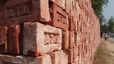 Stack of bricks for sale located at the roadside in Dhaka, Bangladesh. — Stock Video