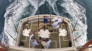 Men prepare rods and reels for fishing onboard fishing boat in Flic en Flac, Mauritius. — Vidéo