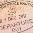 Passport page with Mauritius immigration control departure stamp with traditional Dodo bird depicted on it. — Stock Photo #73852143