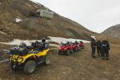 Tourists join the excursion on off-road vehicles near Longyearbyen, Norway. — Stock Photo