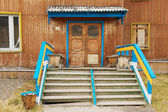 Exterior of the deserted building entrance at the abandoned Russian arctic settlement Pyramiden, Norway. — Stock Photo
