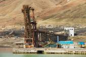 View to the pier of abandoned Russian arctic settlement Pyramiden, Norway. — Stock Photo