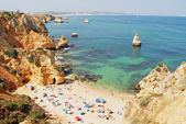 People relax at Praia da Dona Ana beach in Lagos, Portugal. — Stock Photo