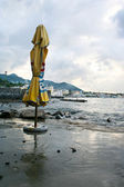 ISCHIA, ITALY - AUGUST, 14: Alone umbrella in cloudy day in Ischia Ponte, August 14, 2007 — Stock Photo