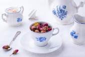 Japanese porcelain cup with rose tea — Stock Photo