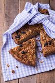 Cut banana cake with oatmeal and raisins granola top — Stock Photo