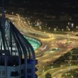 Highway intersection at night with tower from rooftop timelapse. Dubai, UAE — Stock Video #68707509