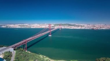 25th of April Suspension Bridge over the Tagus river, connecting Almada and Lisbon in Portugal timelapse — Stock Video