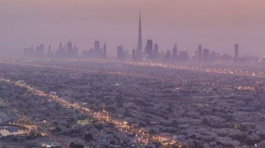 Skyline view of Dubai from night to day transition, UAE. Timelapse — Stock Video