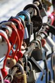 Locks enamoured on a metal protection — Stock Photo