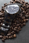 Black watch and coffee on black — Stock Photo