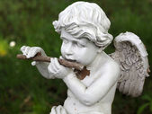 Statue of eros playing flute — Foto Stock