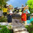 Постер, плакат: Statues of the snakes in Ulun Danu temple Beratan lake