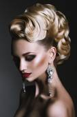 Beautiful hair style and earrings — Stock Photo