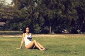 Young woman resting laying on grass in the park — Stock Photo