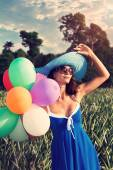 The girl with balloons. Vintage style — Stock Photo