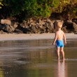 Small white baby boy walking on the beach — Stock Photo #64740963