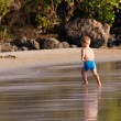 Small white baby boy walking on the beach — Stock Photo #64741575