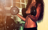 Fitness wonam with dumbbells. Close-up shot of torso — Stock Photo