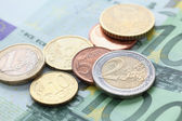 Euro notes and coins — Stock Photo