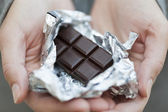 Chocolate bar in silver foil — Stock Photo