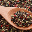 Mixed peppercorns in a wooden spoon — Stock Photo #63967847