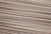 Raw soba noodles background — Stock Photo