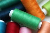 Colorful spools of sewing threads — Stock Photo