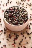 Mixed peppercorns in a wooden bowl — Stock Photo